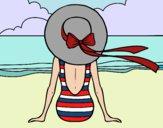 Mulher que olha o mar