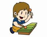 Menino com xilofone