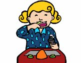 Menina a lavar os dentes