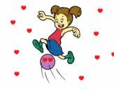 Menina a jogar futebol