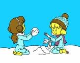 Meninas que jogam com neve
