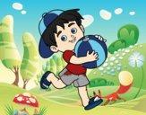 Desenho Criança que joga com esfera de praia pintado por luzinda
